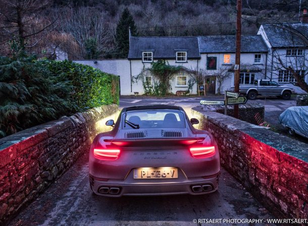 Porsche 911 Turbo S at a bridge in Brecon Beacons Wales UK