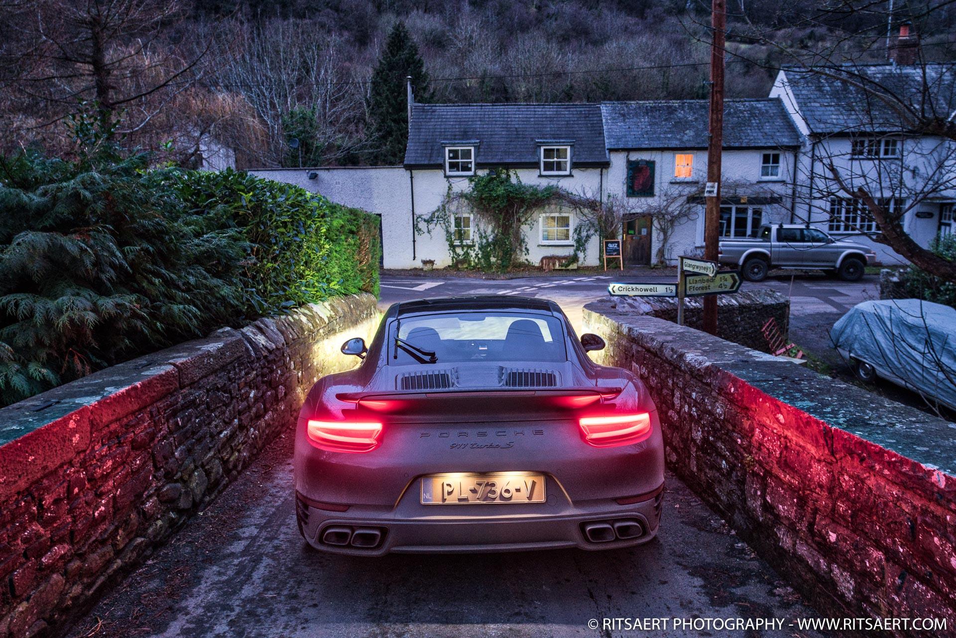 Porsche 911 Turbo S at a bridge in Brecon Beacons Wales UK