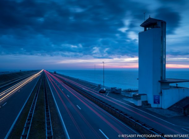 Find the Porsche 911 at a winter sunrise Afsluitdijk Holland